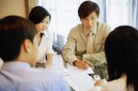 Young executives, having a meeting. - Alex Microstock02