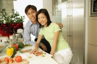 Couple in kitchen, looking at camera - Alex Microstock02