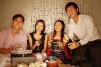 Couples sitting down, looking at camera, women holding wine glass - Alex Microstock02