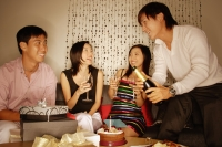 Couples sitting down, side by side, women holding wine glass - Alex Microstock02
