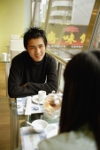 Couple at cafe, sitting face to face - Alex Microstock02