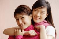 Two young women, smiling, portrait - Alex Microstock02