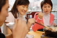 Young adults eating at a restaurant - Alex Microstock02