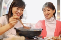 Young women having soup at restaurant - Alex Microstock02