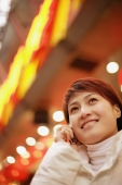 Young woman using mobile phone, looking up - Alex Microstock02