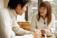 Young adults at a cafe, talking, side by side - Alex Microstock02