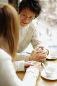 Young couple at a restaurant, talking, face to face - Alex Microstock02