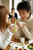 Couple eating at a restaurant - Alex Microstock02