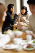 Couples eating at a restaurant - Alex Mares-Manton