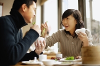 Young couple eating at a Chinese restaurant - Alex Mares-Manton