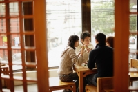Young couples eating at a Chinese restaurant - Alex Mares-Manton