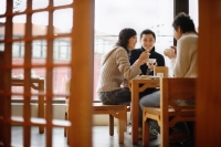 Young couples at a Chinese restaurant, low angle view - Alex Mares-Manton