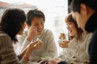 Group of friends eating at a Chinese restaurant - Alex Mares-Manton