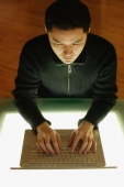 Young man using laptop, high angle view - Alex Microstock02