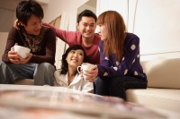 Friends sitting around at home - Alex Microstock02