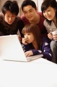 Friends sitting around laptop - Alex Microstock02