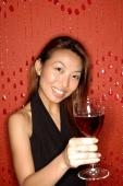 Woman holding wine glass, smiling - Alex Microstock02