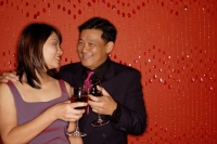 Couple looking at each other, holding wine glasses - Alex Microstock02