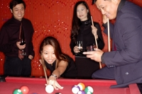 Men and women playing pool - Alex Microstock02