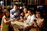 Group of people raising wine glasses, looking at camera - Alex Microstock02