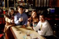Couples raising wine glasses, looking at camera - Alex Microstock02