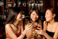 Three women having drinks - Alex Microstock02