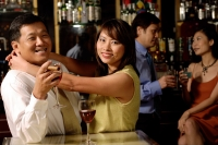 Couple looking at camera, woman hugging man - Alex Microstock02