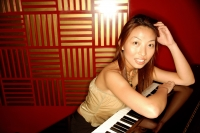 Woman leaning on piano, looking at camera - Alex Microstock02