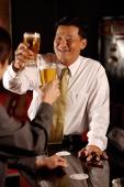 Two men raising beer glasses - Alex Microstock02