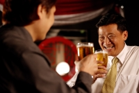 Two men drinking beer together - Alex Microstock02