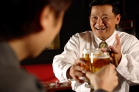 Two men toasting with beer glasses. - Alex Microstock02