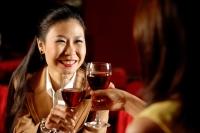 Two women toasting with wine glasses. - Alex Microstock02