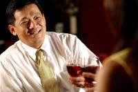 Two men toasting with wine glasses. - Alex Microstock02