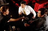 Two men at bar counter, bartender serving them - Alex Microstock02