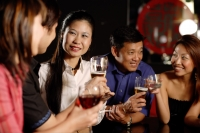 Friends having drinks at bar, sitting in a row - Alex Microstock02