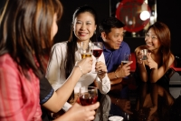 Friends at a bar, holding drinks - Alex Microstock02