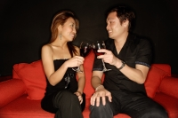 Couple toasting with drinks, sideview - Alex Microstock02