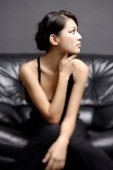 Young woman looking away, hand on chin - Alex Microstock02
