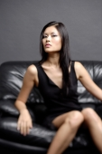 Young woman on chair, looking at camera - Alex Microstock02