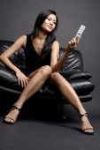 Young woman holding mobile phone - Alex Microstock02