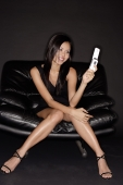 Young woman looking at mobile phone, smiling - Alex Microstock02