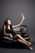 Young woman looking up at mobile phone, smiling - Alex Microstock02