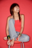 Young woman laughing, holding nail polish - Alex Microstock02