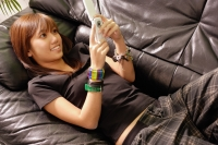Young woman lying on sofa using mobile phone. - Alex Microstock02