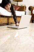 Woman at home, using laptop - Alex Microstock02