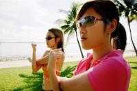 Women doing exercises in park - Alex Microstock02