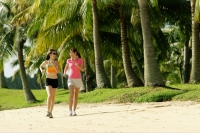 Women jogging along beach - Alex Microstock02
