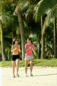 Women jogging along beach, side by side - Alex Microstock02