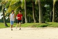 Men jogging along beach, side by side - Alex Microstock02