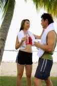 Couple standing at beach, face to face - Alex Microstock02